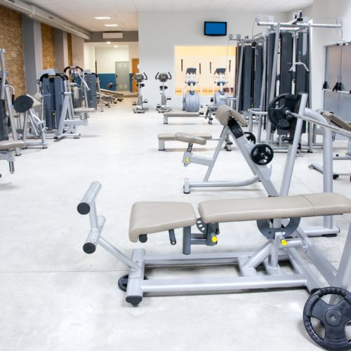 11982242 - fitness club gym with sport equipment modern interior
